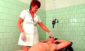 Mature nurse in gloves fingers his asshole