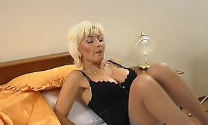 Big tits matured blonde loves doggystyle pounding in bed