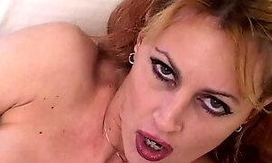 Hot milf rubs her tits and fingers her pussy alone on the bed