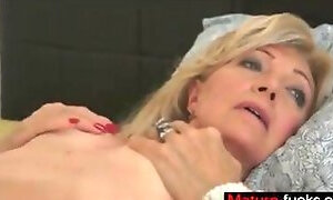 Mature blonde beauty gets a hardcore pounding in bed