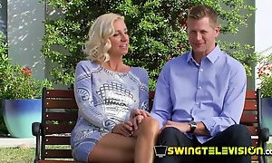 Horny swinger couple discusses some issues before heading to the party