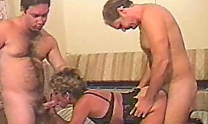 Husband shares his swinging wife with a friend in a vintage clip