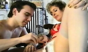 Insatiable mature lady has a young man banging her holes doggy style